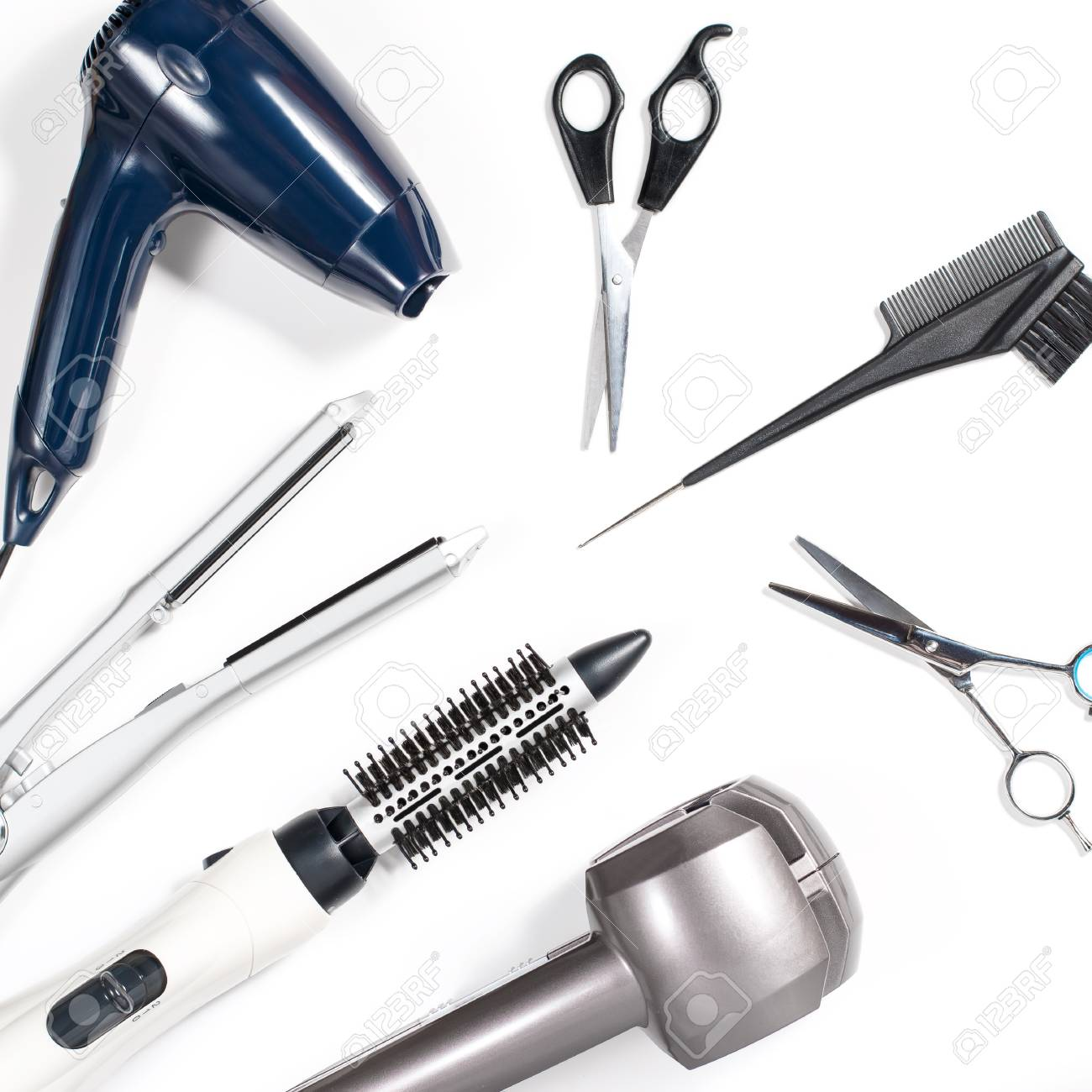 Various hair styling tools on white background, top view, copy space